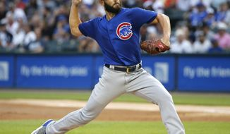 Chicago Cubs starting pitcher Jake Arrieta delivers during the first inning of the team's baseball game against the Chicago White Sox on Wednesday, July 26, 2017, in Chicago. (AP Photo/Charles Rex Arbogast)