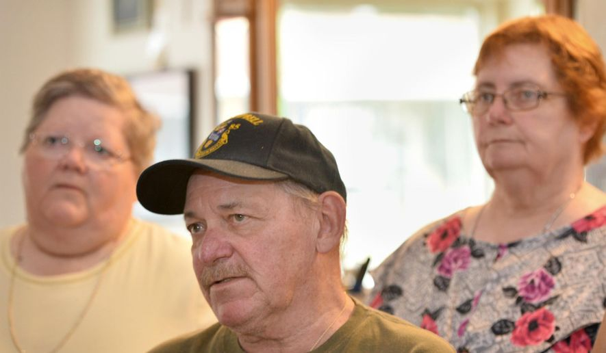 ADVANCE FOR WEEKEND EDITIONS - In this July 10, 2017, photo, Carole Rickrode, 69, from left, Robert Rickrode, 67, and Diane Garren, 70, visit their brother Ed Rickrode's barber shop in Wesleyville, Pa. They were remembering when their mother Lucille Rickrode, who was 43 at the time, was fatally shot by a stranger in her Greene Township home on July 24, 1967. (Christopher Millette/Erie Times-News via AP)