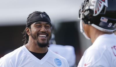 Atlanta Falcons outside linebacker Vic Beasley (44) laughs as he talks with teammate Jack Crawford (95) during NFL football training camp Thursday, July 27, 2017, in Flowery Branch, Ga. (AP Photo/John Bazemore)