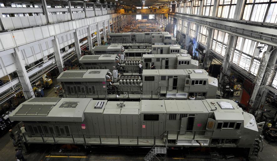 This photo taken Sept. 15, 2011, shows General Electric Evolution Series locomotives being assembled in Building 10 at GE Transportation in Lawrence Park Township, Erie County, Pa. Plant officials announced Thursday, July 27, 2017, that, after more than 100 years of production at the Erie-area plant, locomotive production, except for prototypes, by the end of 2018. All locomotive production is being transferred to GE Transportation's Fort Worth, Texas plant. (Christopher Millette/Erie Times-News, via AP)
