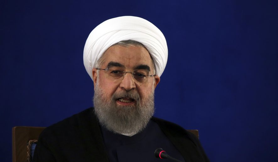 FILE - In this May 22, 2017, file photo, Iranian President Hassan Rouhani speaks at a news conference in Tehran, Iran. The Trump administration is pushing for inspections of suspicious Iranian military sites in a bid to test the strength of the nuclear deal that President Donald Trump desperately wants to cancel, senior U.S. officials said. The inspections are one element of what is designed to be a more aggressive approach to preventing Iran from obtaining a nuclear weapon. (AP Photo/Vahid Salemi, File)