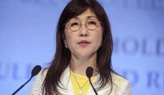 In this June 3, 2017, file photo, Japanese Defense Minister Tomomi Inada speaks at the second plenary session at the 2017 International Institute for Strategic Studies (IISS) Shangri-la Dialogue, an annual defense and security forum in Asia, in Singapore. (AP Photo/Joseph Nair)