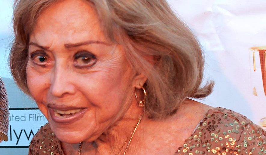 June Foray, shown here at the 2014 Annie Awards. (By Voice Chasers - http://www.flickr.com/photos/voicechasers/12306817566/, CC BY 2.0, https://commons.wikimedia.org/w/index.php?curid=31007111)