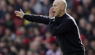 FILE - In this Oct. 15, 2016, file photo, Swansea manager Bob Bradley directs his players during an English Premier League soccer match against Arsenal at The Emirates Stadium in London. A person with knowledge of the decision tells The Associated Press that Bob Bradley will be the first coach of the Los Angeles Football Club, the MLS expansion franchise due to begin play next year. The person spoke to the AP on condition of anonymity Thursday, July 27, 2017, because LAFC's hiring won't be officially announced until Friday. (AP Photo/Tim Ireland, File)