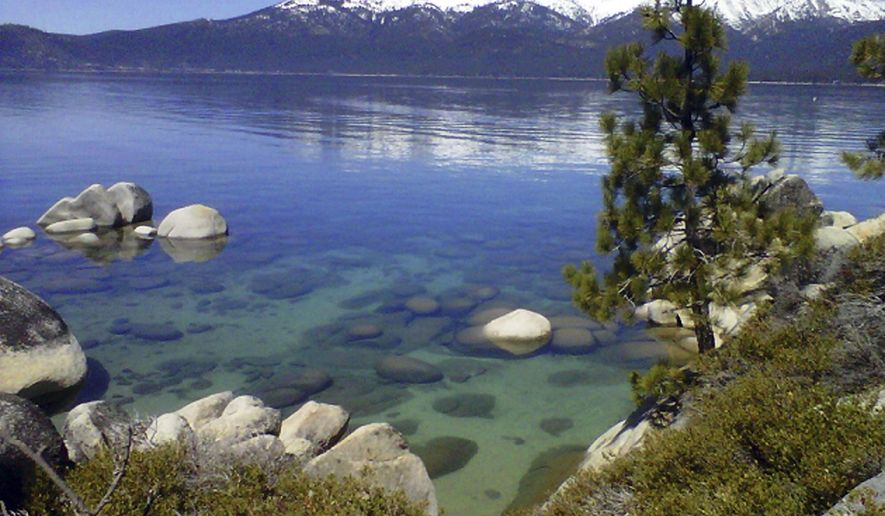 FILE - This April 12, 2012 file photo shows Lake Tahoe seen from Incline Village, Nev. An annual report on Lake Tahoe said the United States' largest alpine lake is still warming at 14 times the historic average. The finding is in the yearly report released Thursday, July 27, 2017, by the University of California at Davis on the state of Lake Tahoe, which straddles the California and Nevada borders. (AP Photo/Scott Sonner, File)