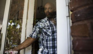 """ADVANCE FOR USE TUESDAY, AUG. 1, 2017 AND THEREAFTER-Earl Rice Jr. steps out of his home in Wilmington, Del., Thursday, May 18, 2017. Jailed at 17 for a purse-snatching that took a woman's life, he is 61 now. """"For 43 years I'm behind a wall or some kind of a fence with guard towers ... and then you come out here,"""" he says. """"I can imagine what Buzz Aldrin and Neil Armstrong and them felt like going to the moon, because that's what it seems like. I'm on a different planet!"""" (AP Photo/Matt Rourke)"""
