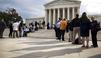 ADVANCE FOR USE MONDAY, JULY 31, 2017 AND THEREAFTER-FILE - In this Tuesday, Oct. 13, 2015 file photo, people line up outside of the Supreme Court in Washington as the justices began to discuss sentences for juvenile prison 'lifers.' In the Monday, Jan. 25, 2016 decision for Montgomery v. Louisiana, the court ruled that people serving mandatory life-without-parole terms for murders they committed as teenagers must have a chance to seek their freedom. The plaintiff, Henry Montgomery, recently learned he will get a chance at parole, 54 years after the killing. (AP Photo/Jacquelyn Martin, File)