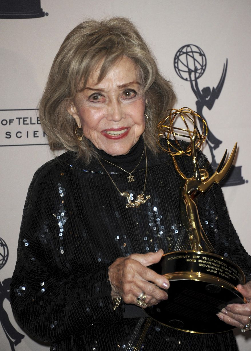 FILE - In this Sept. 15, 2013 file phtoo, June Foray poses backstage with the Governor's Award at the Primetime Creative Arts Emmy Awards at the then Nokia Theatre L.A. Live, in Los Angeles.  Foray's niece, Robin Thaler, said Thursday, July 27, 2017, that Foray died at Wednesday in a Los Angeles hospital of cardiac arrest. She was 99. (Photo by Richard Shotwell/Invision/AP, File)