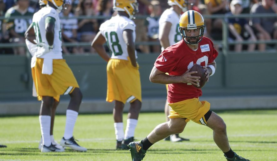 Green Bay Packers' Aaron Rodgers runs a drill during NFL football training camp Thursday, July 27, 2017, in Green Bay, Wis. (AP Photo/Morry Gash)