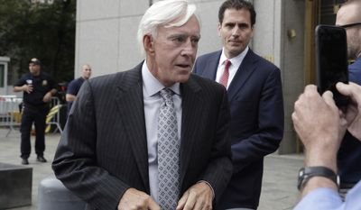 """Las Vegas gambler William """"Billy"""" Walters, left,, accompanied by one of his attorneys, leaves Manhattan federal court, in New York, Thursday, July 27, 2017. Walters, linked to golfer Phil Mickelson, was sentenced to five years in prison for his conviction on insider trading charges.(AP Photo/Richard Drew)"""