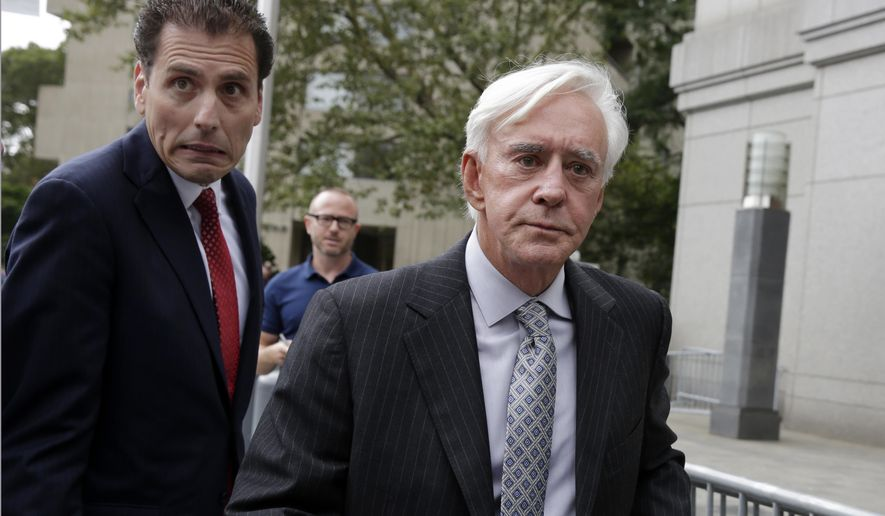 "Las Vegas gambler William ""Billy"" Walters, right, accompanied by one of his attorneys, leaves Manhattan federal court, in New York, Thursday, July 27, 2017. Walters, linked to golfer Phil Mickelson, was sentenced to five years in prison for his conviction on insider trading charges.(AP Photo/Richard Drew)"