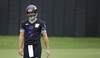 FILE - In this May 25, 2017, file photo, Baltimore Ravens quarterback Joe Flacco walks on the field during NFL football practice at the team's practice facility, in Owings Mills, Md. Flacco is nursing a bad back. The nine-year veteran is expected to miss Baltimore's first training camp practice, and could be sidelined much longer.  (AP Photo/Patrick Semansky, File)