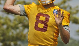 Washington Redskins quarterback Kirk Cousins (8) tosses a pass during NFL football training camp in Richmond,. Va., Thursday, July 27, 2017. (AP Photo/Steve Helber)