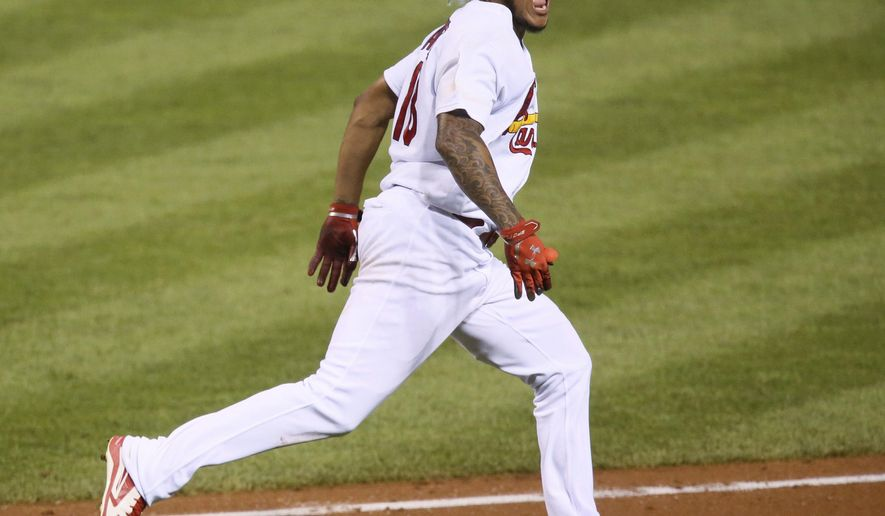 St. Louis Cardinals' Carlos Martinez reacts towards the dugout as he runs to first base with an RBI single during the fourth inning against the Colorado Rockies in a baseball game Wednesday, July 26, 2017, at Busch Stadium in St. Louis. (Chris Lee/St. Louis Post-Dispatch via AP)
