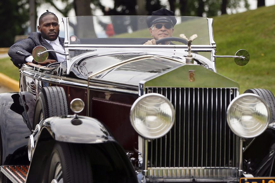 Pittsburgh Steelers wide receiver Antonio Brown, left, arrives in a chauffeur driven 1931 Rolls Royce Phantom 1 at NFL football training camp in Latrobe, Pa., Thursday, July 27, 2017 . (AP Photo/Keith Srakocic)