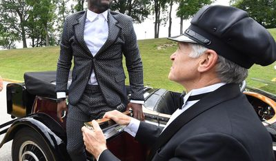 Chaffeur Jon Leimkuehlier, right, holds open a car door as Pittsburgh Steelers wide receiver Antonio Brown arrives at NFL football training camp Thursday, July 27, 2017, in a 1931 Rolls Royce Phantom 1 in Latrobe, Pa. (Peter Diana/Pittsburgh Post-Gazette via AP)