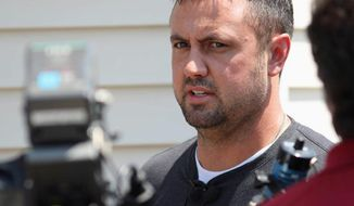 In this Monday, July 24, 2017, photo, Brian Pyle, owner of Pyle Transportation Inc., the Iowa trucking company linked to the deadly case of immigrant smuggling in Texas, speaks to reporters in Schaller, Iowa. The company had long promoted itself as an American success: a family firm whose hard-working drivers helped keep the nation's economy running. Pyle has denied any knowledge of human smuggling. (Jared Strong/Carroll Daily Times Herald via AP)
