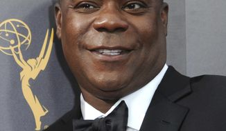 "FILE - In this Sept. 10, 2016 file photo, Tracy Morgan arrives at the Creative Arts Emmy Awards in Los Angeles. Morgan said he's a better man since the 2014 roadway accident that left him critically injured and killed his friend, comedian James McNair. His remarks were made during a Q&A session to promote his new TBS comedy series, ""The Last O.G."" where he plays an ex-con who finds the life and New York neighborhood he left behind is gone. (Photo by Richard Shotwell/Invision/AP, File)"