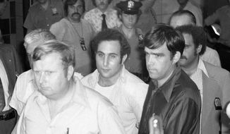 "FILE - In this Aug. 11, 1977 file photo, serial killer David Berkowitz, known as ""Son of Sam,"" arrives at Brooklyn Courthouse in New York. A new documentary on the Smithsonian Channel paints a portrait of the fearful, dysfunctional New York City before Berkowitz was captured. (AP Photo/Ira Schwarz, File)"