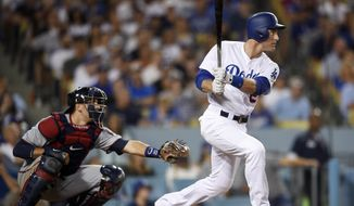 Los Angeles Dodgers' Chase Utley watches his two=run double in front of Minnesota Twins catcher Jason Castro during the seventh inning of a baseball game in Los Angeles, Wednesday, July 26, 2017. (AP Photo/Kelvin Kuo)