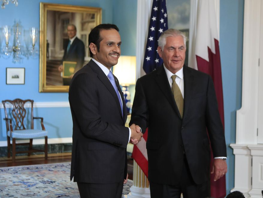 Secretary of State Rex Tillerson shakes hand with Qatar's Foreign Minister Sheikh Mohammed bin Abdulrahman Al Thani during a meeting at the State Department in Washington, Wednesday, July 26, 2017. (AP Photo/Manuel Balce Ceneta)