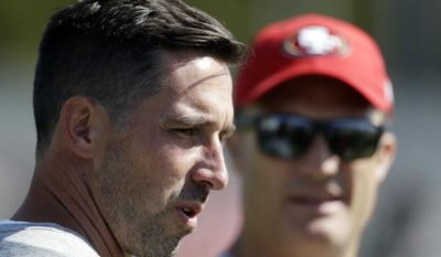 San Francisco 49ers head coach Kyle Shanahan, left, watches practice with general manager John Lynch during NFL football training camp Friday, July 28, 2017, in Santa Clara, Calif. (AP Photo/Marcio Jose Sanchez)