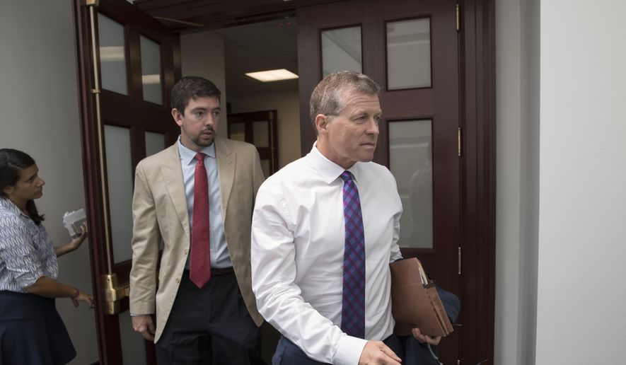Rep. Charlie Dent, R-Pa., a member of the House Appropriations Committee, emerges from a House Republican Conference meeting on Capitol Hill in Washington, Friday, July 28, 2017. (AP Photo/J. Scott Applewhite)