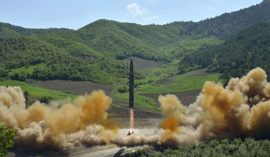 In this July 4, 2017, file photo, distributed by the North Korean government shows what was said to be the launch of a Hwasong-14 intercontinental ballistic missile in North Korea. North Korea fired a ballistic missile Friday night, July 28, which landed in the ocean off Japan, Japanese officials said. (Korean Central News Agency/Korea News Service via AP, File)