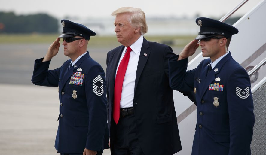 President Donald Trump steps off Air Force One after arriving at Long Island MacArthur Airport in Ronkonkoma, N.Y., Friday, July 28, 2017, to speak on the street gang MS-13. (AP Photo/Evan Vucci) ** FILE **