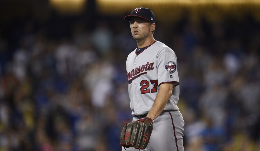 Minnesota Twins' Brandon Kintzler in action during the ninth inning of a baseball game against the Los Angeles Dodgers in Los Angeles, Wednesday, July 26, 2017. (AP Photo/Kelvin Kuo)