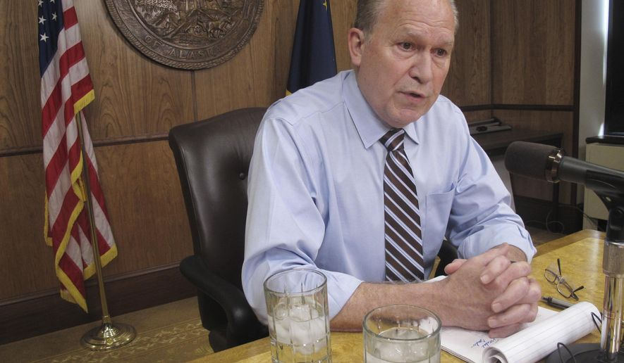 FILE - In this June 8, 2017 file photo, Alaska Gov. Bill Walker meets with reporters in Juneau, Alaska. Walker says he will probably run for re-election but currently has more pressing issues on his mind, including crafting a tax bill that he hopes will garner support from lawmakers, Friday, July 28, 2017. (AP Photo/Becky Bohrer, File)
