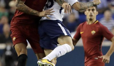 AS Roma's Aleksandar Kolarov, left, and Tottenham's Kieran Trippier go up for the ball during the first half of an International Champions Cup soccer match, Tuesday, July 25, 2017, in Harrison, N.J. (AP Photo/Julio Cortez)