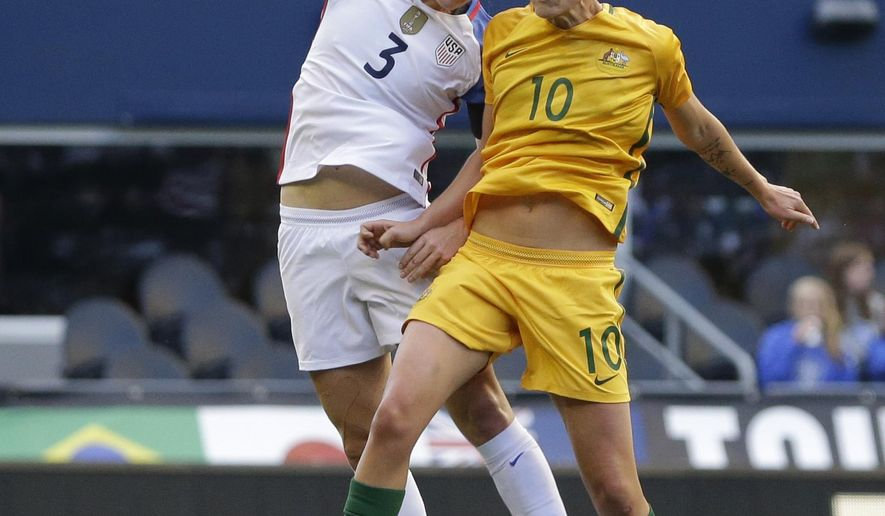 United States' Samantha Mewis (3) and Australia's Emily van Egmond (10) go for a head ball during the first half of a Tournament of Nations women's soccer match, Thursday, July 27, 2017, in Seattle. (AP Photo/Ted S. Warren)