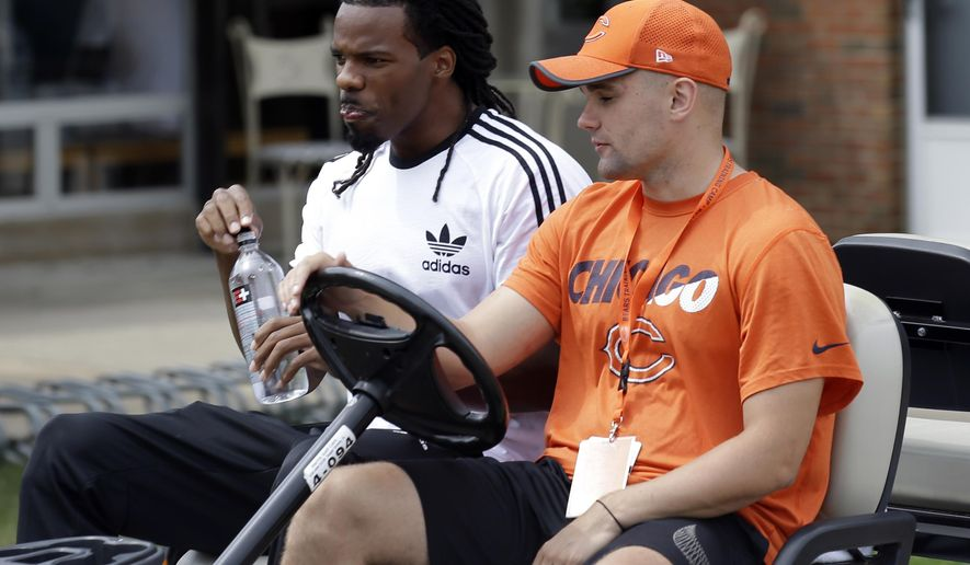 Chicago Bears wide receiver Kevin White, left, arrives for an NFL football training camp in Bourbonnais, Ill., Wednesday, July 26, 2017. (AP Photo/Nam Y. Huh)