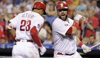 Philadelphia Phillies' Aaron Altherr, left, and Cameron Rupp celebrate Altherr's solo home during the fifth inning of a baseball game against the Atlanta Braves, Friday, July 28, 2017, in Philadelphia. (AP Photo/Tom Mihalek)