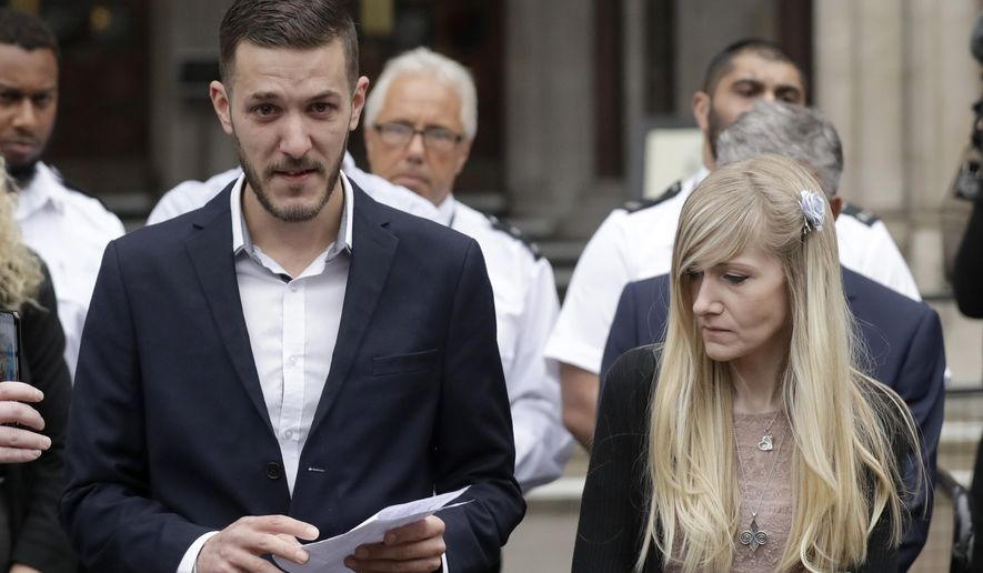 FILE - In this file photo dated  Monday, July 24, 2017, Chris Gard, the father of critically ill baby Charlie Gard reads a statement next to mother Connie Yates, right, at the end of their case at the High Court in London.  British media are reporting a family announcement that 11-month old Charlie Gard, has died Friday July 28, 2017. (AP Photo/Matt Dunham, FILE)