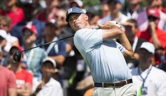Matt Kuchar, of the United States, hits his tee shot on the fifth hole  during the second round of the Canadian Open golf tournament at Glen Abbey Golf Club, Friday, July 28, 2017,  in Oakville, Ontario. (Nathan Denette/The Canadian Press via AP)