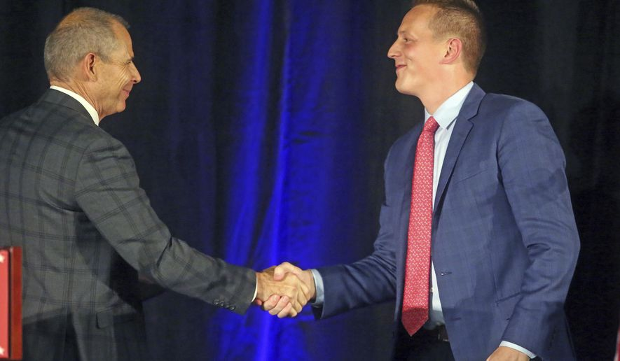 Republican candidates John Curtis, left, and Tanner Ainge shake hands following a debate at the Utah Valley Convention Center Friday, July 28, 2017, in Provo, Utah. Republican candidates Chris Herrod, Curtis, and Ainge, vying for the seat vacated by U.S. Rep. Jason Chaffetz, debated on topics ranging from health care to religious freedom. (AP Photo/Rick Bowmer)