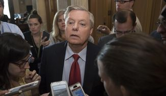 Sen. Lindsey Graham, R-S.C., is surrounded by reporters as he arrives at the Senate chamber on Capitol Hill in Washington, Thursday, July 27, 2017. (AP Photo/J. Scott Applewhite) ** FILE **