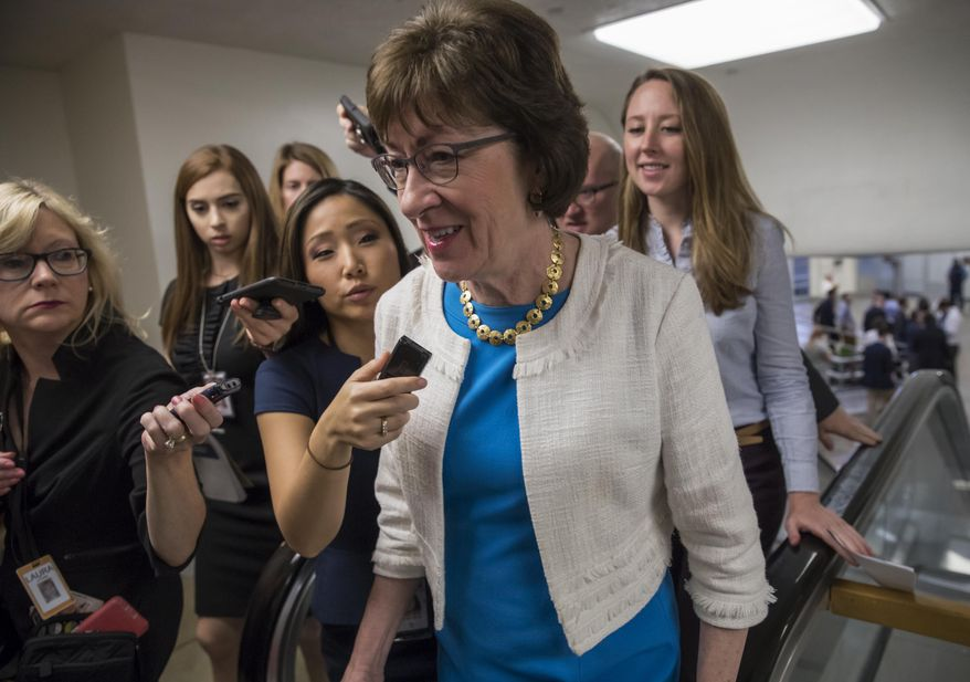 """Sen. Susan Collins, R-Maine is surrounded by reporters as she heads to the Senate on Capitol Hill in Washington, Thursday, July 27, 2017, while the Republican majority in Congress remains stymied by their inability to fulfill their political promise to repeal and replace """"Obamacare"""" because of opposition and wavering within the GOP ranks. (AP Photo/J. Scott Applewhite)"""