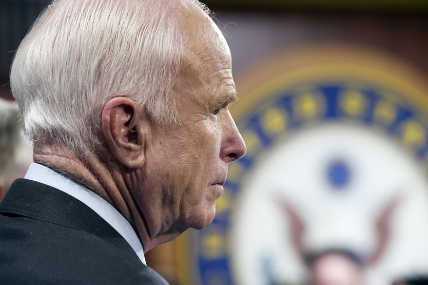 "Sen. John McCain, R-Ariz., speaks to reporters at the Capitol as the Republican-controlled Senate unable to fulfill their political promise to repeal and replace ""Obamacare"" because of opposition and wavering within the GOP ranks, on Capitol Hill in Washington, Thursday, July 27, 2017. (AP Photo/Cliff Owen)"