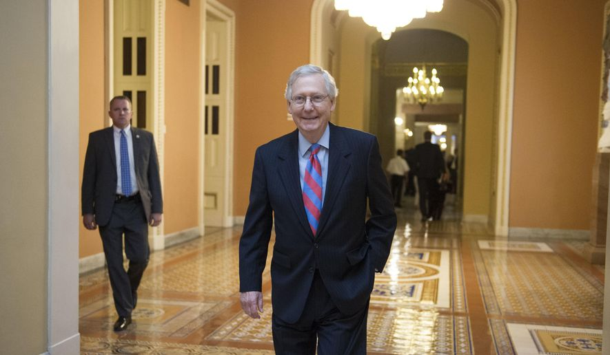 "Senate Majority Leader Mitch McConnell of Ky. heads to the Senate on Capitol Hill in Washington, Thursday, July 27, 2017, as the Republican majority in Congress remains stymied by their inability to fulfill their political promise to repeal and replace ""Obamacare"" because of opposition and wavering within the GOP ranks. (AP Photo/Cliff Owen)"