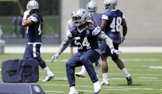 FILE - In this June 13, 2017, file photo, Dallas Cowboys outside linebacker Jaylon Smith runs through a drill during an NFL football practice at the team's training facility, in Frisco, Texas.  Jaylon Smith was mostly hidden from view rehabbing a knee injury during his first training camp with the Dallas Cowboys a year ago. Now the former Notre Dame standout, taken in the second round of the 2016 draft with the Cowboys, is finally on the field. (AP Photo/Tony Gutierrez, File)