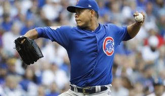 Chicago Cubs starting pitcher Jose Quintana throws during the first inning of a baseball game against the Milwaukee Brewers Friday, July 28, 2017, in Milwaukee. (AP Photo/Morry Gash)