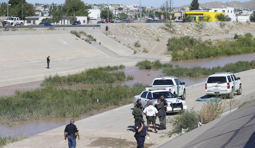 A fifth person has died this week in the El Paso area after being pulled from the Rio Grande while attempting to cross from Mexico. U.S. Border Patrol agents were conducting a river patrol Thursday with Mexican law enforcement officials when the body of a man believed to be in his 30s was found. The discovery comes after the bodies of three people, all Guatemalan nationals, were recovered Tuesday, July 25, 2017, after they drowned while trying to cross. (Ruben R. Ramirez/The El Paso Times via AP)