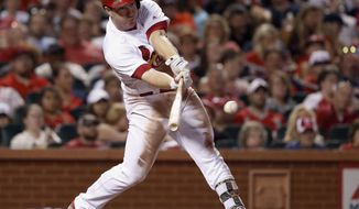 St. Louis Cardinals' Jedd Gyorko hits an RBI-single during the sixth inning of a baseball game against the Arizona Diamondbacks, Friday, July 28, 2017, in St. Louis. (AP Photo/Jeff Roberson)