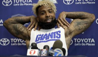 New York Giants wide receiver Odell Beckham stretches while talking to reporters at NFL football training camp, Friday, July 28, 2017, in East Rutherford, N.J. (AP Photo/Julio Cortez)
