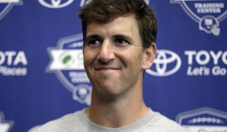 New York Giants quarterback Eli Manning talks to reporters at NFL football training camp, Friday, July 28, 2017, in East Rutherford, N.J. (AP Photo/Julio Cortez)
