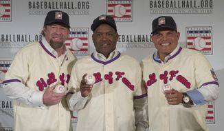 FILE - In this Jan. 19, 2017, file photo, Hall of Fame inductees Jeff Bagwell, left, Tim Raines, center, and Ivan Rodriguez, poses for a photo during a news conference, in New York. Bagwell, Raines, Rodriguez, Bud Selig and John Schuerholz each carved his own niche in major league baseball, and on Sunday they will receive the game's ultimate reward _ induction into the Hall of Fame. (AP Photo/Mary Altaffer)
