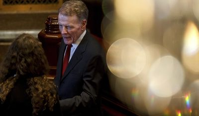 Illinois Speaker of the House Michael Madigan, D-Chicago, talks on the floor of the Illinois House after they came to order and quickly adjourned during the second day of a special session on education funding at the Illinois State Capitol, Thursday, July 27, 2017, in Springfield, Ill. [Justin L. Fowler/The State Journal-Register via AP)